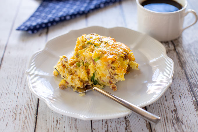 Breakfast casserole on a plate with a fork