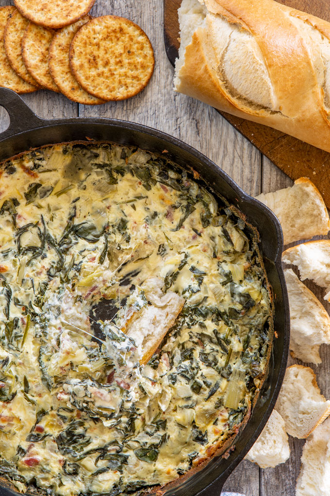 First image of baked artichoke, fresh spinach and bacon dip