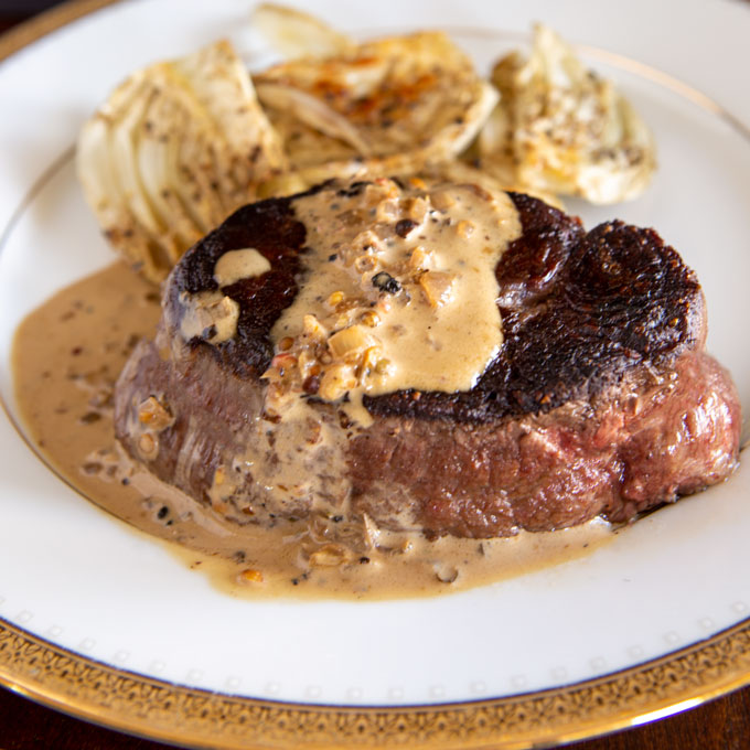 Feature image of the plated beef tenderloin with peppercorn cream sauce