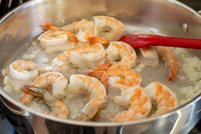 Sauteing the shrimp with the onions and garlic.
