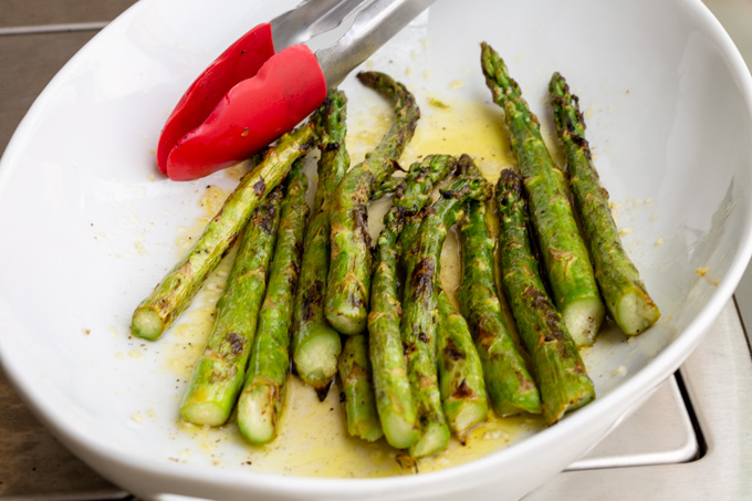 Grilled asparagus back in the marinade platter