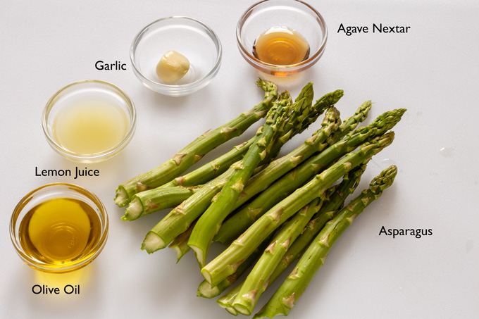 Ingredients for making citrus and garlic grilled asparagus