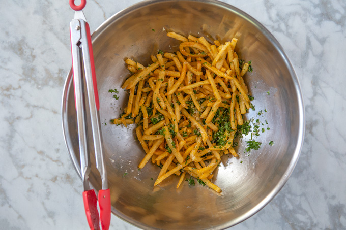 Pomme frites tossed in the olive oil, garlic, parsley and Parmesan