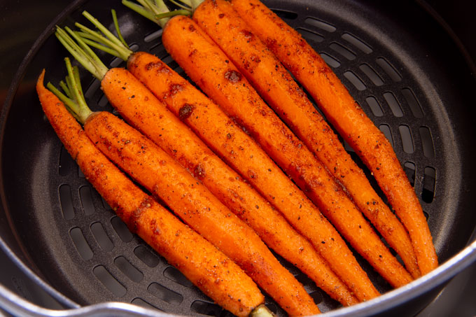 Seasoned carrots in the air fryer before cooking