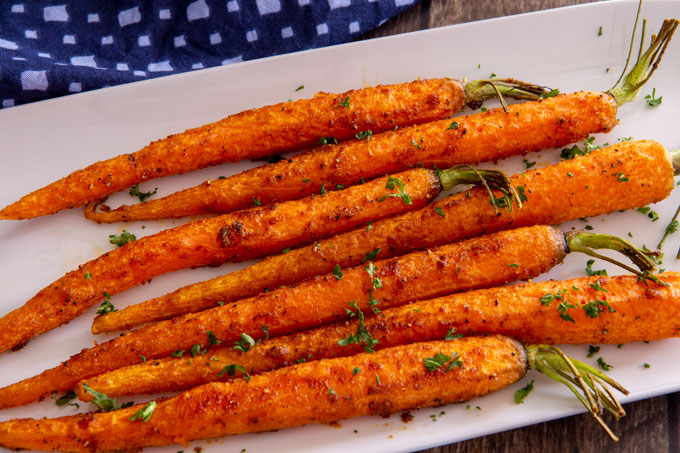 Landscape view of cooked air fryer carrots on a serving dish