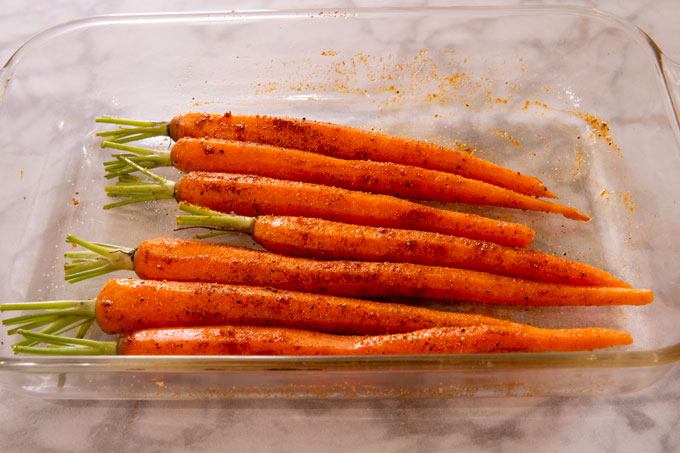 Baby carrots seasoned in a dish