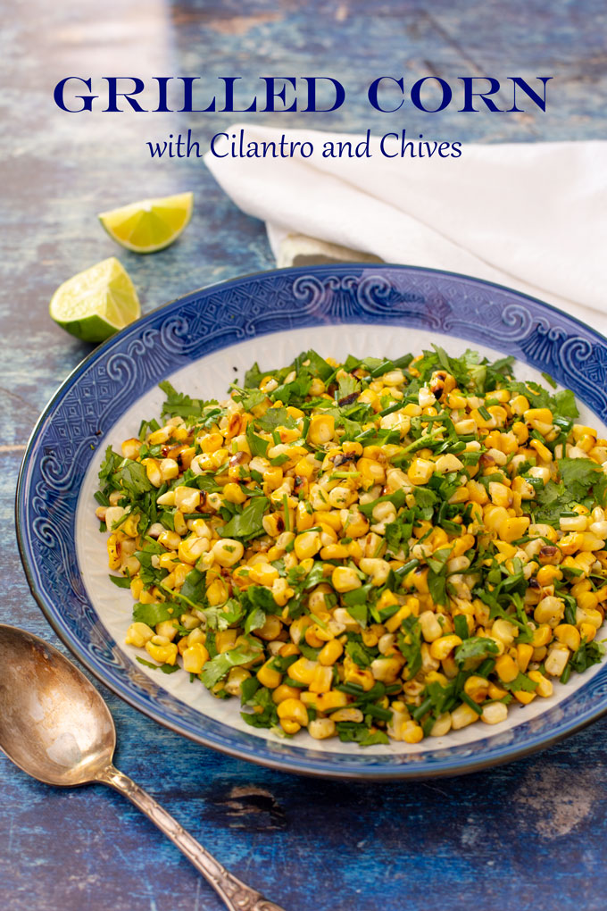 Grilled corn with cilantro and chives side dish in a blue bowl, ready to serve. Banner image with label.