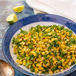 Feature image of grilled corn side dish with cilantro and chives