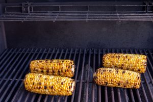 Image of ears of corn on the grill slats after grilling is complete