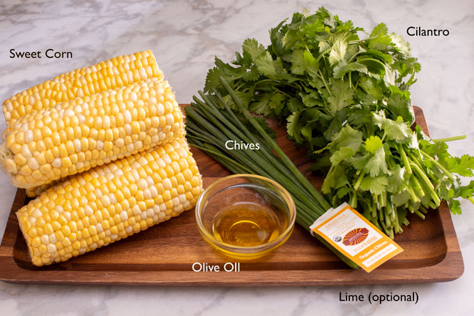 Ingredients for making a side dish of grilled corn with cilantros and chives
