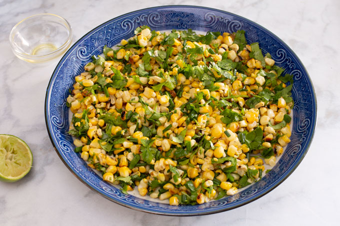 Tossed and seasoned grilled corn with cilantro and chives side dish