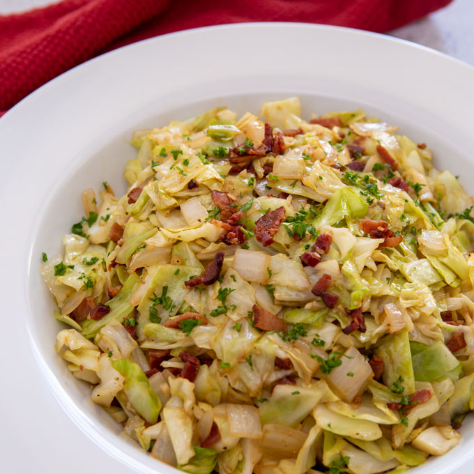 Balsamic fried cabbage in a serving bowl, feature image